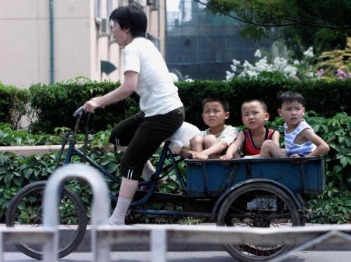 tricycle carrying children