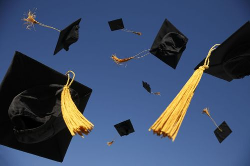 graduation caps thrown in air