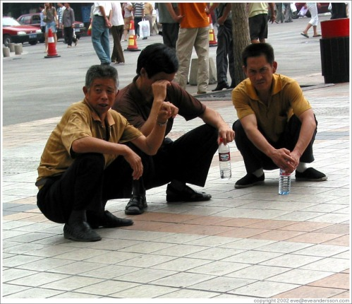 squatting men beijing-wangfujing