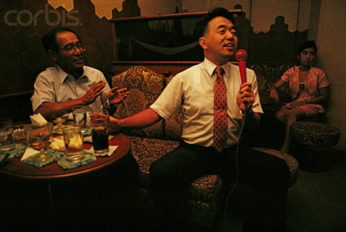 Japanese Businessmen in Karaoke Bar