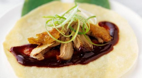 duck and spring onions on crepe