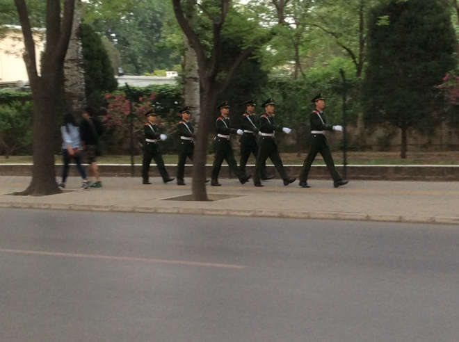 guards marching along the pavement