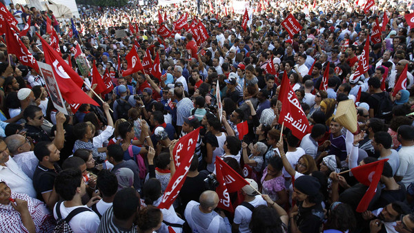 Protesters shout slogans during a demonstration to call for the departure of the Islamist-led ruling coalition in Avenue Habib-Bourguiba in central Tunis