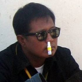 man with inhaler in nose