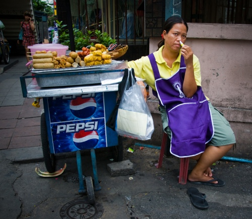 woman vendor with sniffing stick