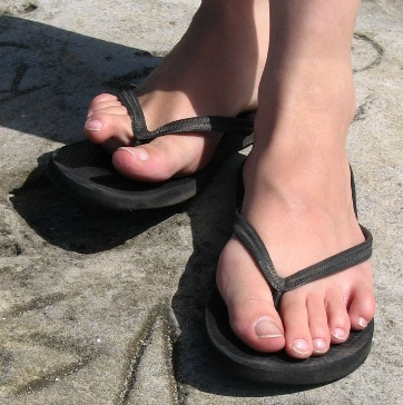 white feet in flip flops