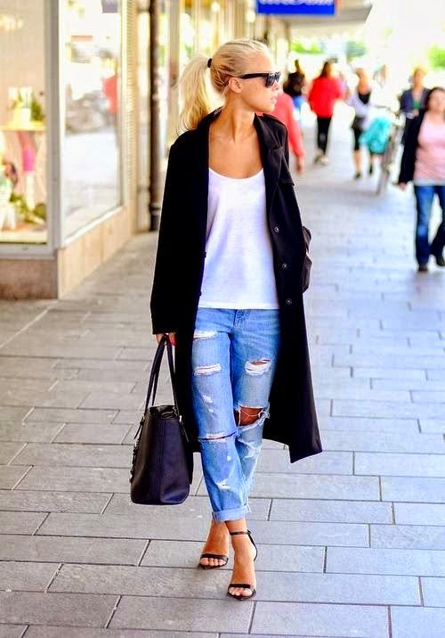 woman in distressed jeans